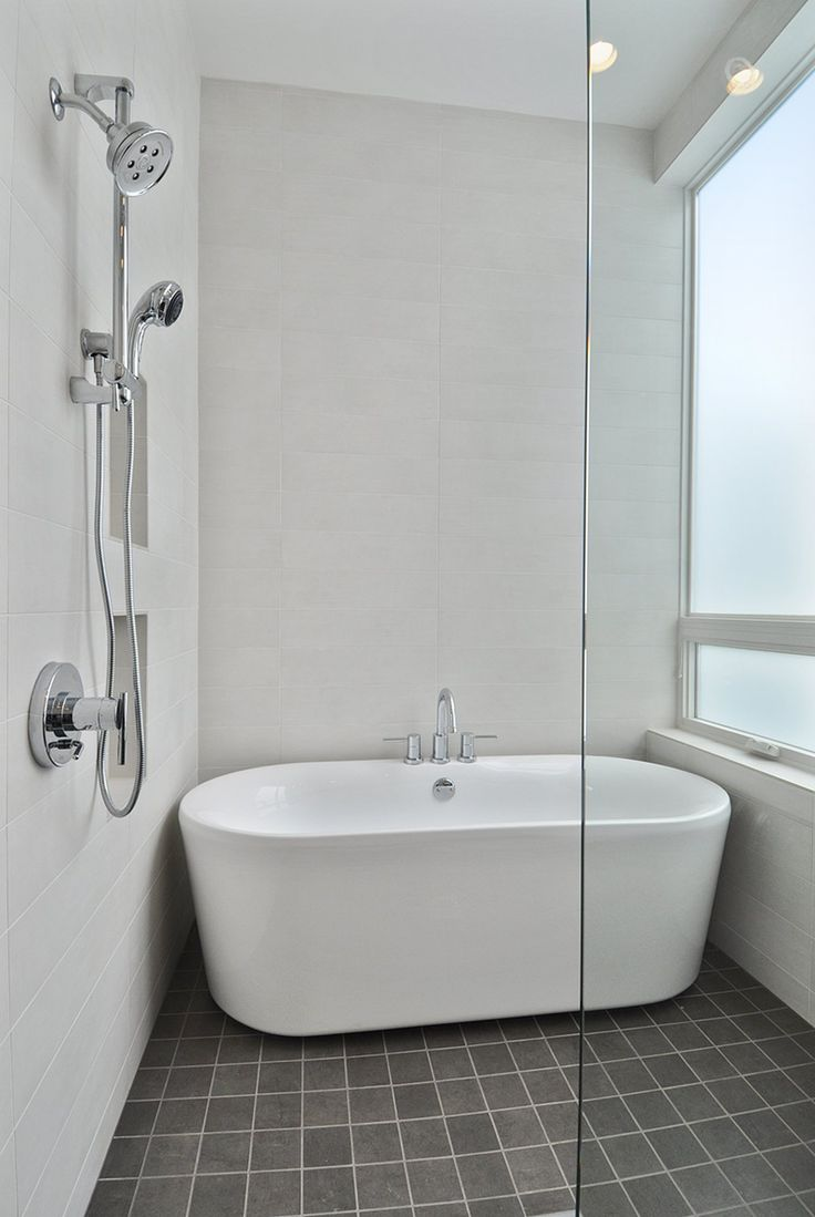 Complete Your Charming Bathroom With Freestanding Tubs Ideas: White Freestanding Tubs On Dark Floor Matched With White Wall And Faucet Shower Plus Frameless Shower Door For Bathroom Decor Ideas