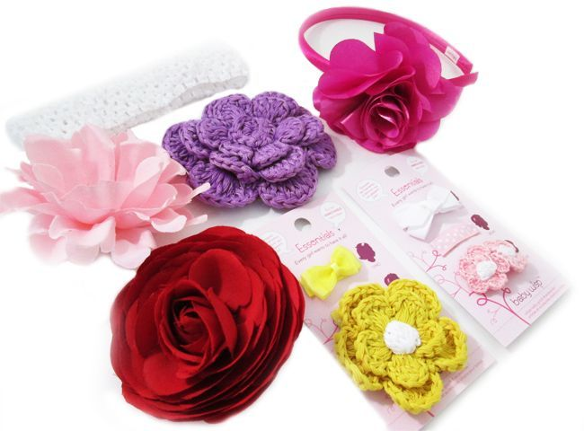 TODDLER SUMMER HAIR ACCESSORIES all in one pack.  A satin headband with a posh fuschia flower red rosebloom with a clip so you can clip into sweaters, hair, hats, headbands and that one - mom can borrow!  Bright Yellow snaps and light pink ponytails!  Crocheted flowers, satin flowers  are sure to be a hit of the season.
