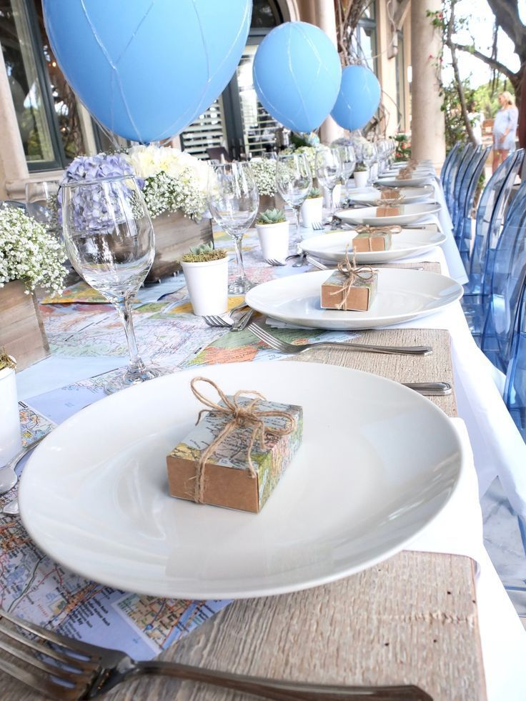 Arrangements of pale blue hydrangeas and Baby Breath, in small wooden crates fro… – Blue Hot Air Balloon Baby Shower Ideas