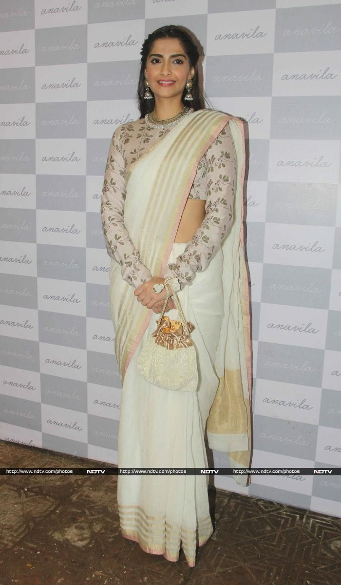 Actress Sonam Kapoor arrived in style for the launch of designer Anavila Misra's store in Mumbai, dressed in a sari from the designer's collection.