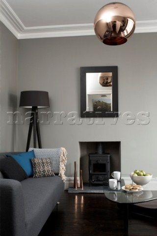 Grey room with wood burner.