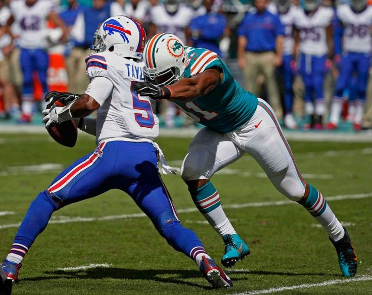Bills vs. Dolphins:    October 23, 2016  -  28-25, Dolphins  -    Miami Dolphins defensive end Cameron Wake (91) sacks Buffalo Bills quarterback Tyrod Taylor (5), during the first half of an NFL football game, Sunday, Oct. 23, 2016, in Miami Gardens, Fla.
