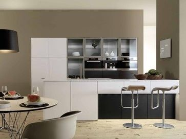 A recognisable interior design concept is characteristic for a well planned kitchen. For instance, certain form elements are repeated and clean contours become distinctly noticeable.