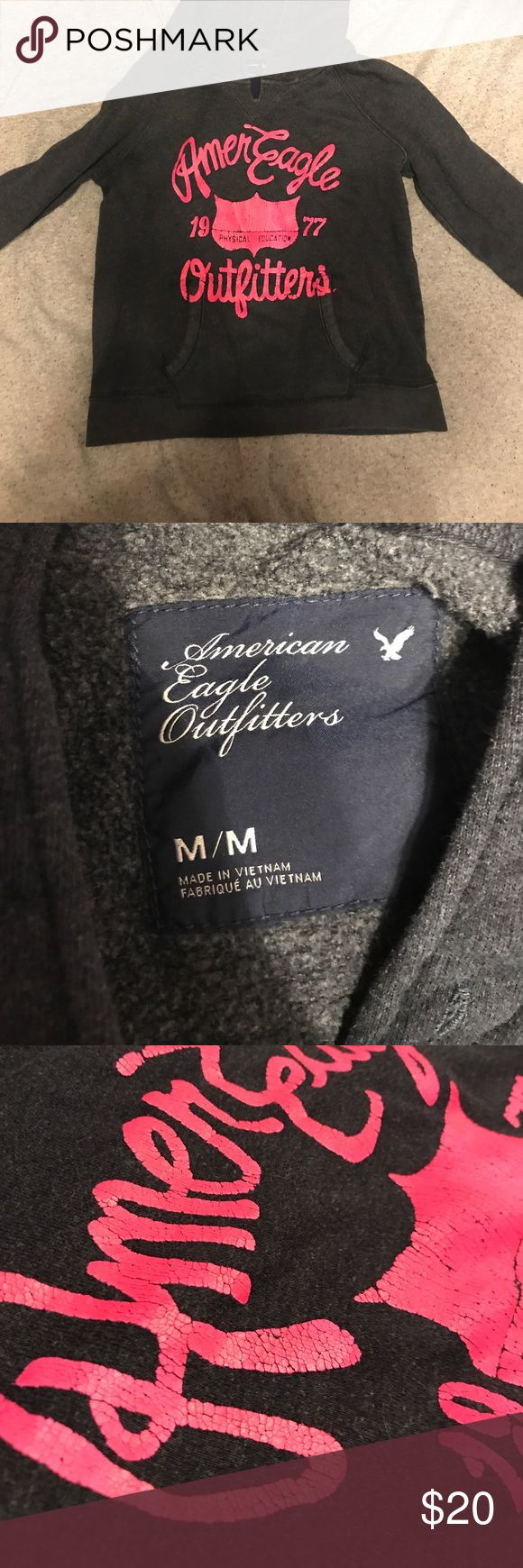 Navy Blue American Eagle Sweatshirt Very comfy, lightly used. Lettering has cracks. Very warm, says the size is a medium but fits like a small. American Eagle Outfitters Sweaters
