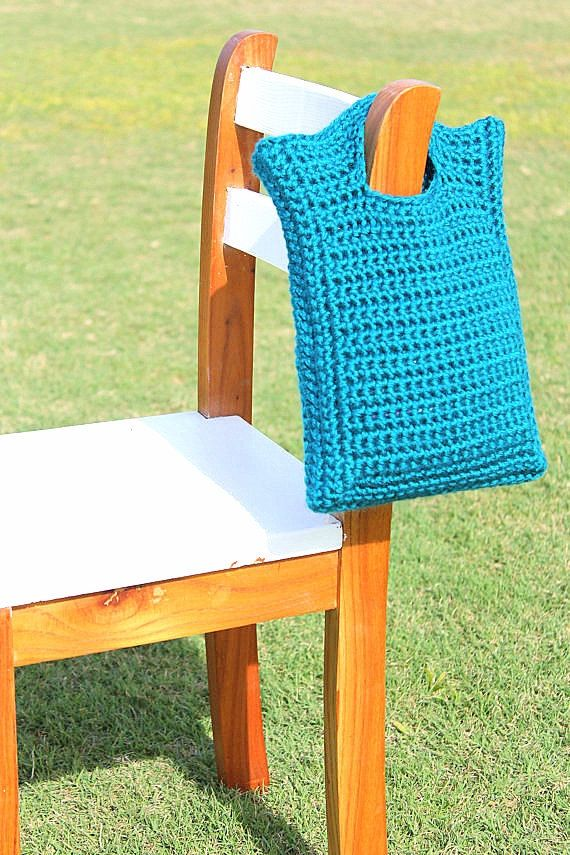 An adorable little purse for that adorable little girl in your life! This beautiful Teal Blue crochet purse/tote is made using two strands of yarn. This technique creates a very strong tight stitch, which ensures the integrity and security of the purse shape, and all of it's contents. It is soft yet durable, and can easily fit over a little girl's hand, should she choose to wear it on her wrist or forearm. It is 8.5 in wide and 10.5 in tall, and made with premium soft acrylic yarn. This…