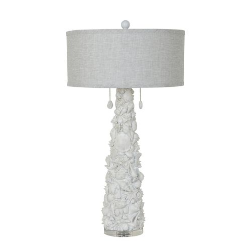 The new Caicos Shell Table Lamp stands 35