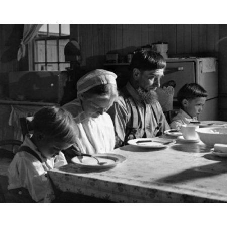 Amish family praying before a meal Canvas Art - (24 x 36)