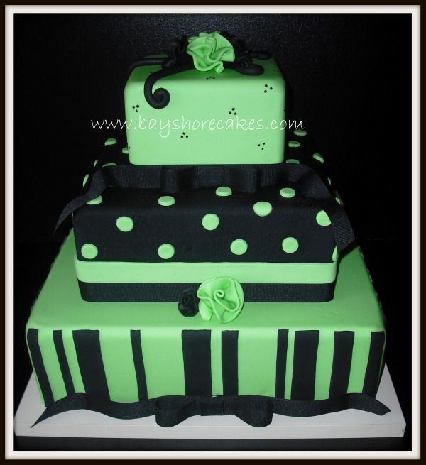 Lime Green and Black Wedding cake - All covered in MM fondant, black ribbon around the base of 2 of the tiers. MM fondant ribbon roses. On the black tier I used an impression rolling pin, but the photo doesn't show it very well. Thank you for looking!