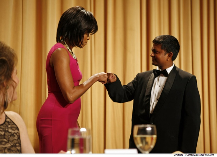 First Lady Michelle Obama gives a congratulatory fist bump to an unnamed scholarship award winner at the annual White House Correspondents' Association gala dinner at the Washington Hilton Hotel in Washington on May 9, 2009.