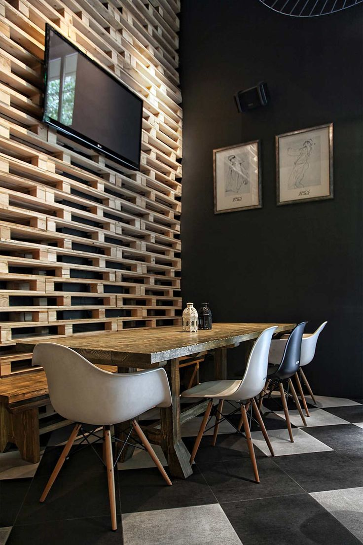 Pallet parts used as a room divider in a music cafe in Athens. This could be really cool if you put it in front of a brightly colored wall! Or as a head board!