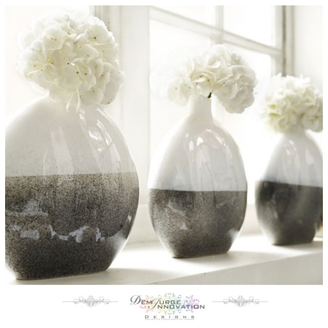 The bulbous shape and fluid lines of this vase are stunning to the eye and it's finished to perfection with the use of contrasting colours. The clean milky white gloss of the top half sits beautifully with the neutral grey gloss of the lower half. Display in a simple line of three for a scene of instant harmony - Available Now #InteriorDesign #HomeJewellery #Stylish #Quality #Elegant #Modern #Trend #HomeFashion #Lifestyle #Decor #Contemporary #InteriorSelfie  #DemiurgeInnovationDesigns