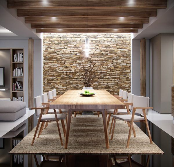rugged stone accent wall is ideal backdrop for the table + chairs