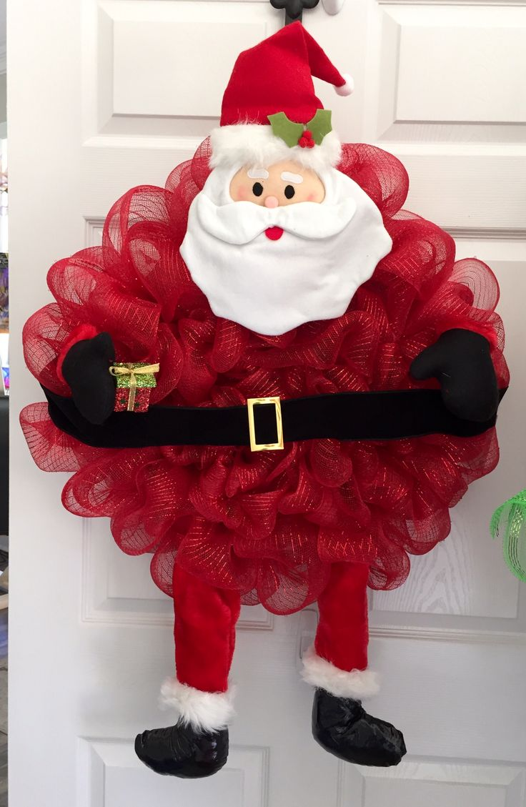 Santa Wreath!  It is adorable by itself or pair it with our elf wreath for double doors!