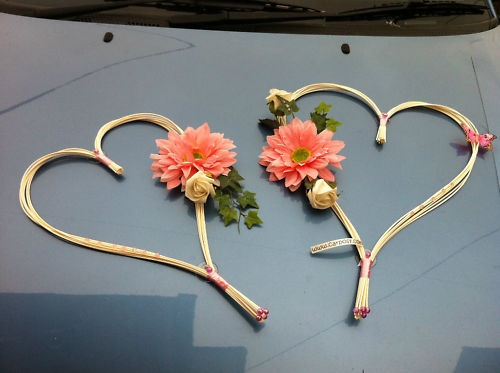 pale pink gerbera on rattan hearts, wedding car decoration, simply stunning
