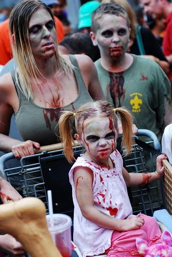 Zombie at San Diego Comic-Con 2013 #SDCC #cosplay I love the little girl!!!!