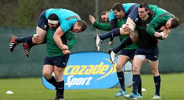 Martin Moore carries Jack McGrath; Jonathan Sexton lifts Dave Kearney and Andrew Boyle shoulders Jordi Murphy at Ireland squad training