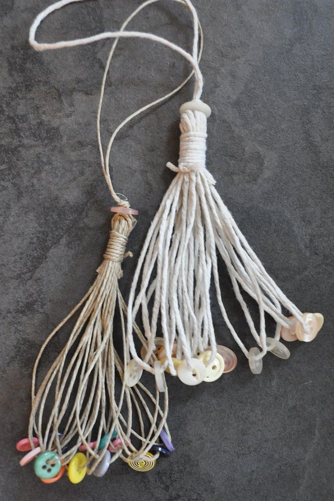 button loop tassels - would make pretty ceiling fan pulls, or drapery tie-backs. More things to do with grama's buttons...