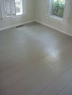 DIY Painted Plywood Floor - Using 8 inch wide lengths of plywood, primer and deck paint, a gal created the floor that so many of us dream of and did it for a mere 45 cents a square foot! That's just $90 for a 200 square foot room! http://www.apartmenttherapy.com/rustic-white-painted-floors-fo-119528