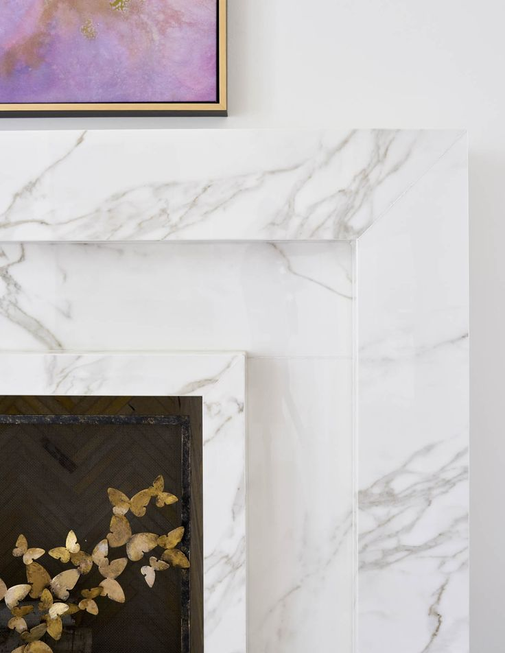 gold butterfly fireplace screen by claire crowe from blue print | custom marble fireplace | interior design by jenkins interiors | blue print | blueprintstore.com