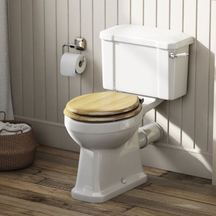 The Bath Co. Camberley close coupled toilet with wooden soft close seat oak effect
