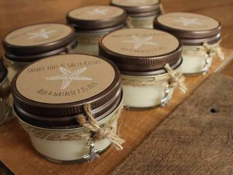 SANDY TOES & SALTY KISSES! These beautiful candle favors capture the essence of a day on the beach and the treasures of the ocean. Each hand poured soy candle is made in small batches with premium soy clean burning soy wax and fragrance oils in a variety of fragrances reminiscent of a day at the beach! The handsome 4oz glass jar with rustic metal top also includes a personalized label and has a metal starfish charm secured with twine. Makes a great shower or wedding favor. Also makes a great…
