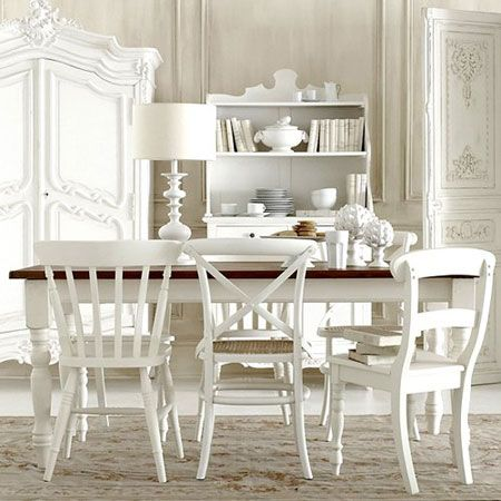 All White Rooms: Painting mixed-match chairs all in the same white color unifies the look in this all white dining room.