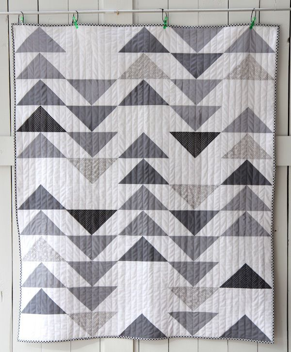 grey goose full front-- For this quilt, I wanted a modern, clean geometric kind of look. So I made Half Square Triangles and did a Flying Geese kind of pattern on the front. I skipped some triangles, to create some additional negative space.