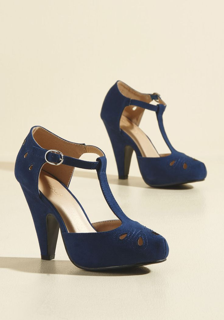Team these playful navy T-straps up with your dynamic dance moves and watch as magic unfolds! The tapered heels, teardrop-shaped cutouts with perforated accents, and faux-suede finish of this ModCloth-exclusive pair all put an oomph into your outfit that reps your other awesome characteristics.
