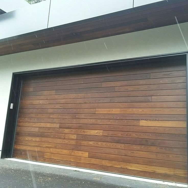 Just when you think you had reached the limit of designs using our thermally modified wood a door comes along. #wood #doors #garage #Novawood #design #Toronto #Ontario #Canada #Ash #greenbuilding #fsc #building #construction #home #custombuilt #custom #houses #housedesign #architecture #door #wooddoors #hardwoods #cladding #doorskins #modifiedwood #curbappeal #streetscape