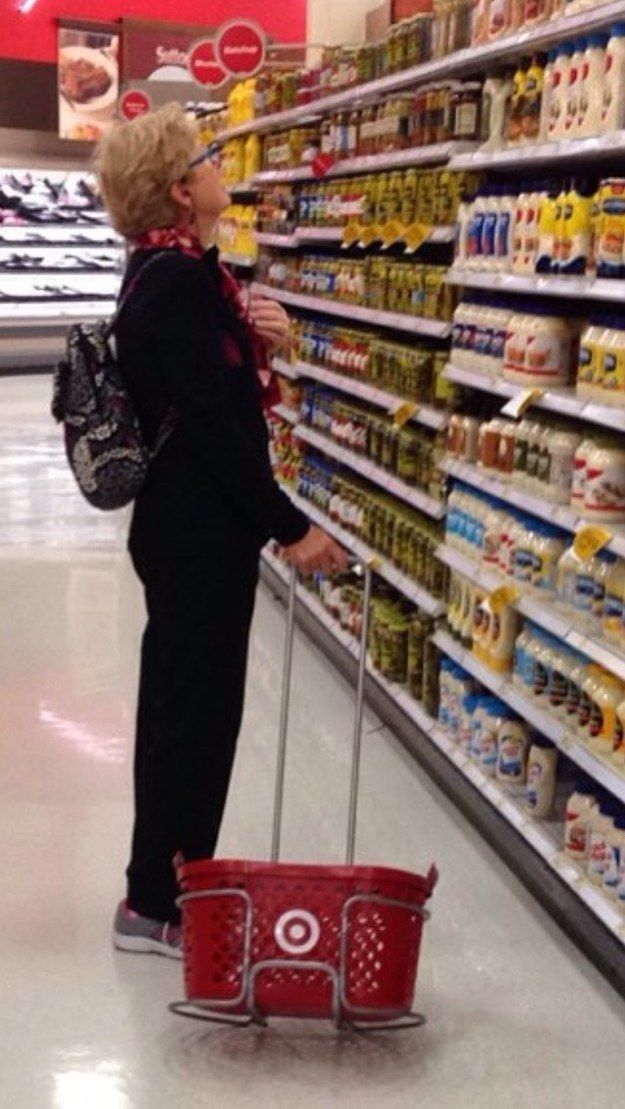 There's a new trend among Target shoppers, first noticed when gatorb888 posted this photo on Reddit, in which a woman appears to be dragging her basket around in the rack, instead of carrying it. | I don't know why I find this so funny but I do!