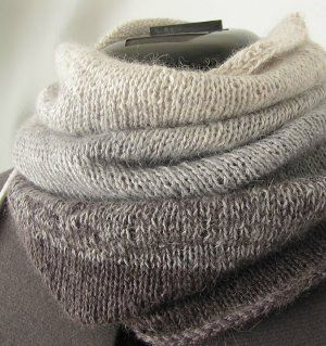 Add style and comfort to your outfit with the fashionable Ombre Cowl. This simple knitted cowl pattern narrows toward the top for a snug, cozy fit that will keep you warm throughout the seasons.