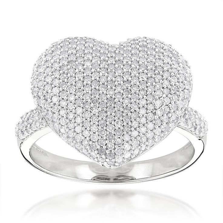 This elegant ring with a heart shaped decor features 308 round-cut diamonds in a pave setting. A high polish finish completes the look.