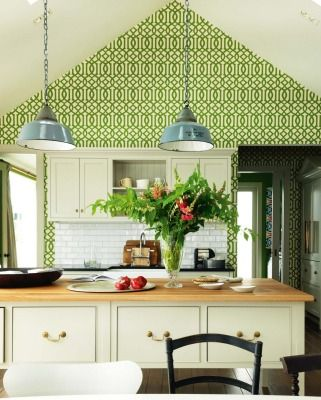 Green Imperial Trellis wallpaper lines the walls in this Christchurch home, with an oak kitchen joinery and antique ...