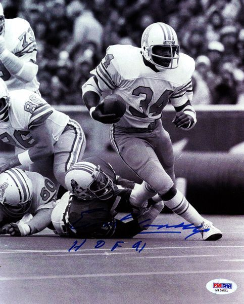 This is a 8x10 Photo that has been hand signed by Earl Campbell. It has been authenticated by PSA/DNA and comes with their sticker and matching certificate.