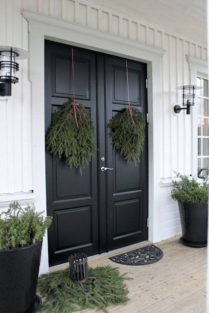 Idea of using cut-off branches from an evergreen instead of a wreath! I'd add some color with bows or fake bright red berries in there.