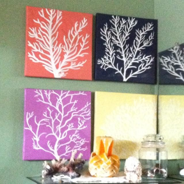 Beachy bathroom. Coral paintings grouped.