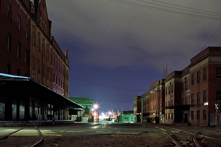 """""""The derelict old wool store buildings in Newstead, Brisbane, Australia.  A four minute exposure taken at around 3am one evening in 1984. Well before the area was modernised and turned into studio apartments."""""""