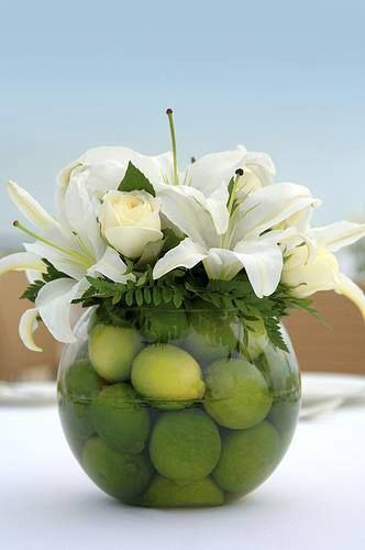 Use fruit in your vases to make your floral displays look fun and that little bit different