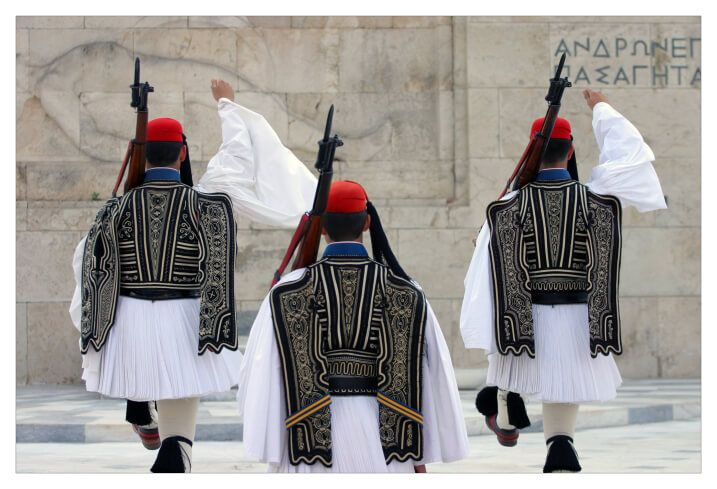 """Evzone Uniform Honors Greece's Historic Past - The term """"evzone"""" can be traced back to Homer's writings. He referred to the elite soldiers of his time as """"Evzones"""" because they were """"well-built"""" (""""zoni"""" means """"belt"""" in Greek). Not much is known about how they actually dressed in Homer's time. However, the fact that he mentioned them shows that the Evzone soldiers have been part of Greek military tradition since Ancient Greece."""