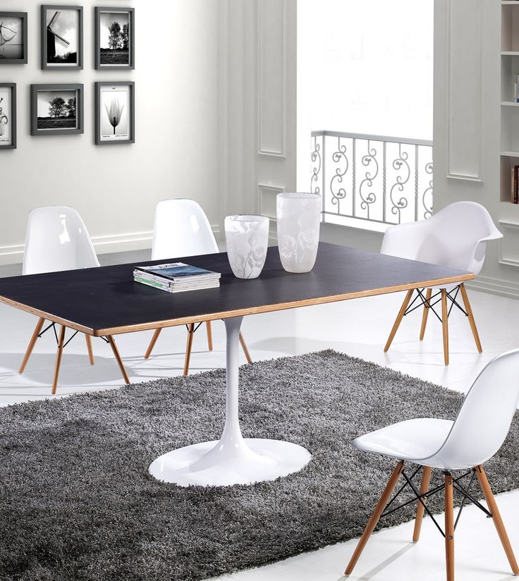 Designer meeting table and chair combination with contrast wooden tones. Wood tones mixed with white and dark tones work to create a modern workspace design.