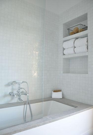 MASTER BATH- non-soaker free standing tup. gray quartz surround, white subway tile. tiles + recessed shelf