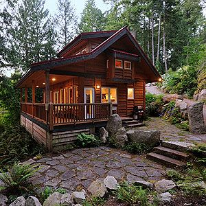Moon Dance Cabin, Pender Harbour. BC, Canada  Everybody loves a covered veranda.  The horizontal cedar siding gives the cabin a very rustic feel.  I also like the flagstone patio.