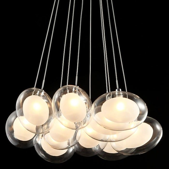 This contemporary ceiling fixture glows with beautiful materials and a spectacular design from Hena series. It features a chrome finish cylindrical ceiling canopy upon which a cluster ten glass ovals are attached via cables. Brilliant halogen bulbs are nestled in pods of opal etched glass within larger pods of clear glass giving a sense of warmth and a welcoming look.