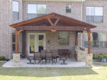 Covered Patio Cabana.  Love the built in kitchen & the stone posts.