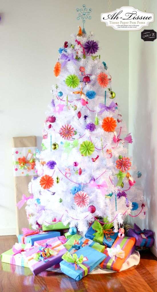 I will be decorating my white Xmas tree with bright colored ornaments and tinsel like this next year!