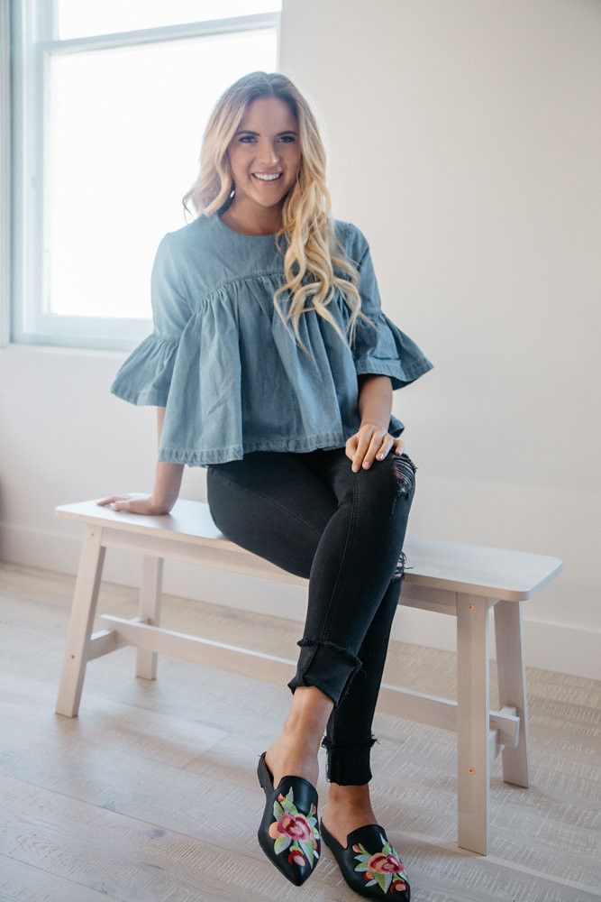 """This darling top is made of sturdy denim and features a back zipper detail. We love the look of this paired with white jeans or a pencil skirt. Model is wearing a small Bust: S- 39"""", M-40"""", L-41"""" Leng"""
