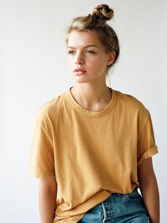 Photos via: Lady Gunn A top knot, basic tee and jeans are my usual weekend go-to. This mustard...