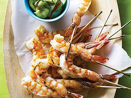 Sesame Shrimp with Cucumber-Soy Salad | Skewering the shrimp makes them easy to eat and attractive for serving. You'll need to presoak wooden skewers for 30 minutes, or use metal skewers.
