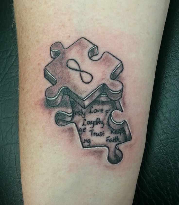 Matching 3D puzzle piece tattoo. Done by Tom Hacic @ RedHouse Tattoo and Piercing
