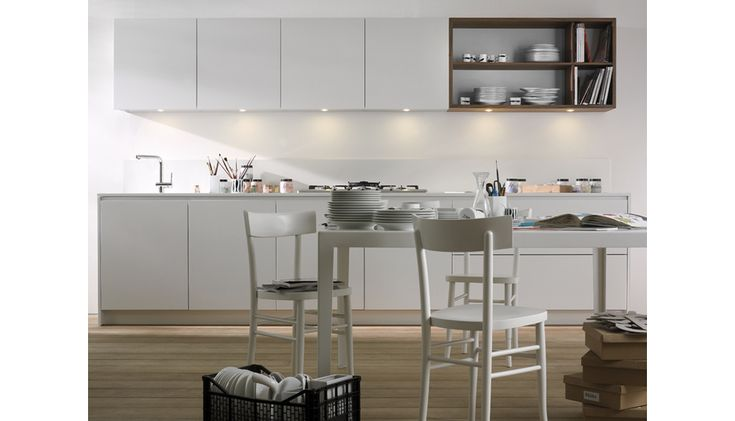 one12 Alfonso Arosio Giuliano Giaroli  One12 reinterprets in an original way the linearity of kitchens without handles. The opening of doors and drawers is made possible by a special exclusive shaping in the upper edge, which enhances the effect of formal unity and offers a firm hold.